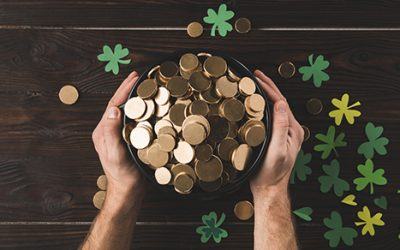 cropped image of man holding pot with golden coins, st patricks day concept